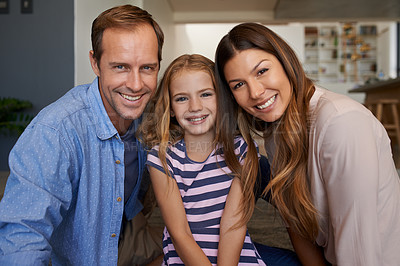Buy stock photo Portrait of a little girl bonding with her parents at home
