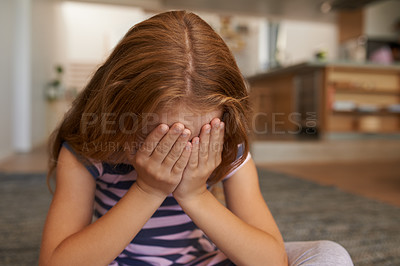 Buy stock photo Shot of a little girl covering her face at home