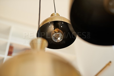 Buy stock photo Shot of lights hanging from a ceiling at home