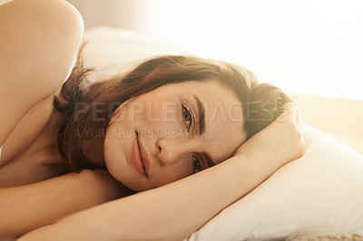 Buy stock photo Shot of a beautiful young woman relaxing on the bed in the morning at home