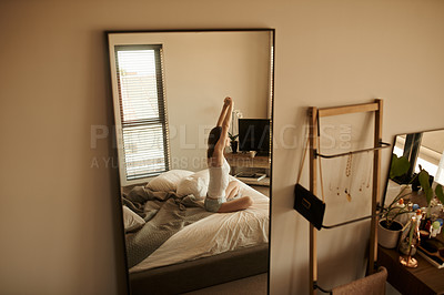 Buy stock photo Shot of a beautiful young woman waking up in bed at home