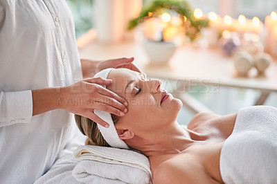Buy stock photo Shot of a mature woman getting a head massage at a spa
