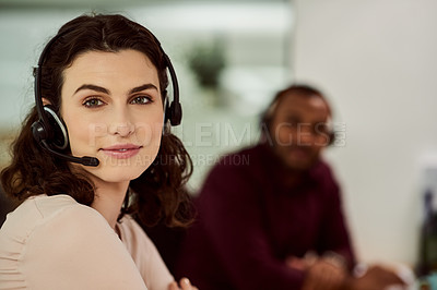 Buy stock photo Portrait shot of a call center agent working in an office