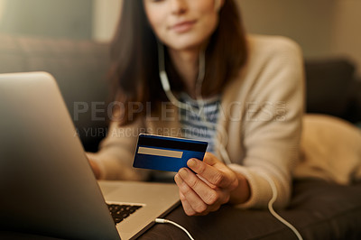 Buy stock photo Closeup shot of a woman using a laptop and credit card at home