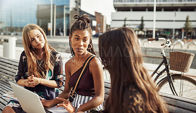 Buy stock photo Shot of young women studying together outdoors