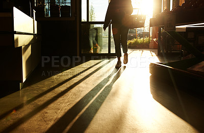 Buy stock photo Cropped shot of a woman walking into a grocery store and holding a basket