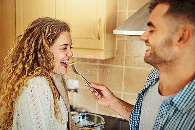 Buy stock photo Cropped shot of a young man feeding his girlfriend pancakes