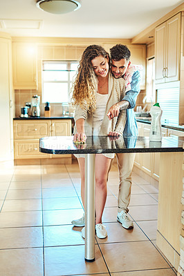 Buy stock photo Cropped shot of a young couple cleaning their house together