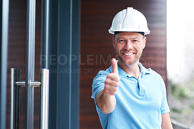 Buy stock photo Portrait of a cheerful engineer posing with his thumbs up outside a building