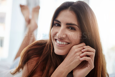 Buy stock photo Shot of a beautiful young woman relaxing on her bed