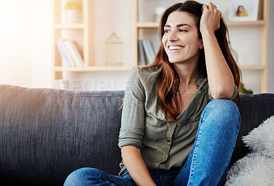 Buy stock photo Shot of a beautiful young woman relaxing in the sofa at home