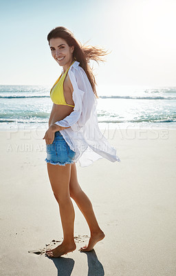 Buy stock photo Shot of a beautiful young woman enjoying her day at the beach