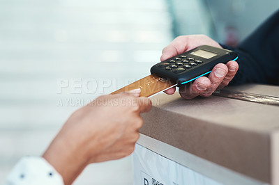 Buy stock photo Shot of an unrecognizable delivery man receiving payment from a female customer for her order