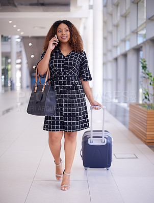 Buy stock photo Shot of a young businesswoman using a smartphone while walking in an airport