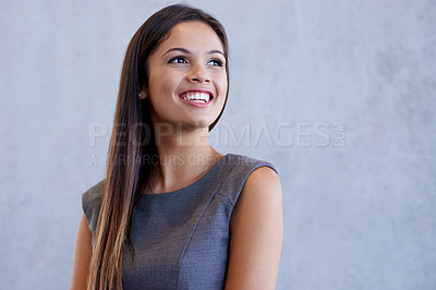 Buy stock photo Studio shot of an attractive young businesswoman standing against a grey background