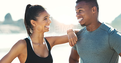 Buy stock photo Cropped shot of a young happy couple out for a workout at the beach