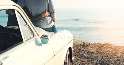 Buy stock photo Rearview shot of an unrecognizable young couple making a stop at the beach while out on a road trip