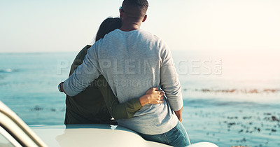 Buy stock photo Rearview shot of a young couple making a stop at the beach while out on a road trip
