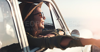 Buy stock photo Cropped shot of an attractive young woman enjoying a roadtrip on a sunny day