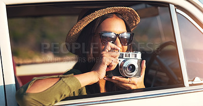 Buy stock photo Cropped shot of an attractive young woman taking photographs while on a road trip