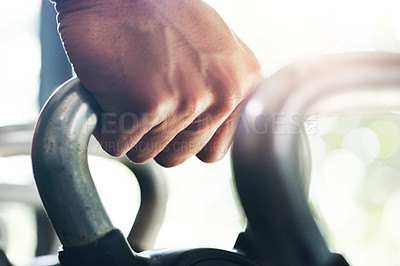 Buy stock photo Closeup shot of an unrecognizable sportsman working out with kettlebells in the gym