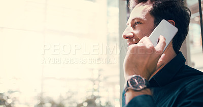Buy stock photo Cropped shot of a businessman talking on a mobile phone in the workplace