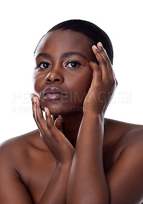 Buy stock photo Portrait of a beautiful young woman touching her face while standing against a white background