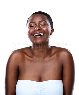 Buy stock photo Studio shot of a beautiful young woman striking a pose and laughing while standing against a white background