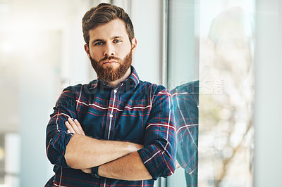 Buy stock photo Cropped portrait of a handsome young male designer standing with his arms crossed in the office
