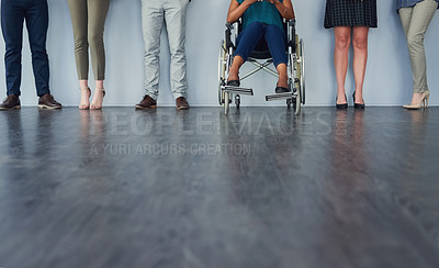 Buy stock photo Low angle shot of a group of unrecognizable business people standing in line against a grey background