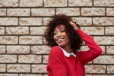 Buy stock photo Cropped shot of a fashionable young woman out in the city