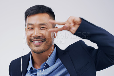 Buy stock photo Studio shot of a handsome young businessman dancing against a grey background
