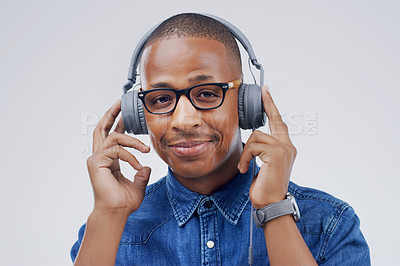 Buy stock photo Studio shot of a handsome young man dancing against a grey background
