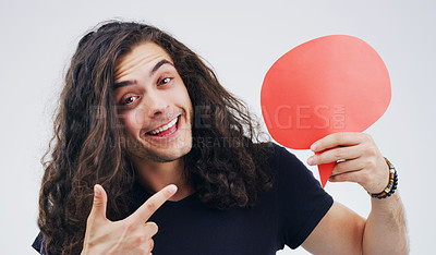 Buy stock photo Portrait of a handsome young man holding a speech bubble against a grey