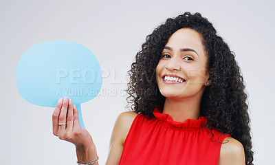 Buy stock photo Portrait of an attractive young woman holding a speech bubble against a grey background