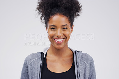 Buy stock photo Studio portrait of an attractive young woman smiling against a grey background