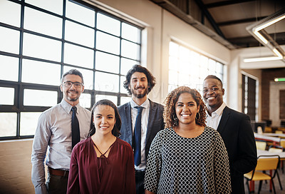 Buy stock photo Cropped portrait of a diverse team of happy businesspeople posing together in their office