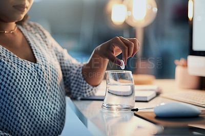 Buy stock photo Closeup shot of an unrecognizable businesswoman dissolving medication in a glass of water