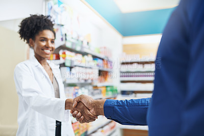 Buy stock photo Cropped shot of a pharmacist and a customer shaking hands