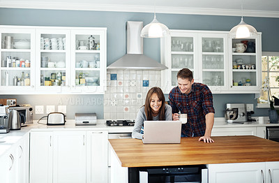 Buy stock photo Cropped shot of a couple using a laptop together at home