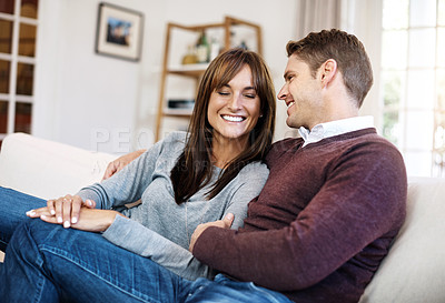 Buy stock photo Cropped shot of a middle aged couple having a relaxing day at home