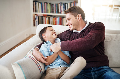 Buy stock photo Shot of a man spending time at home with his son