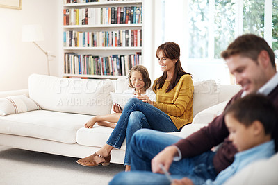 Buy stock photo Shot of a couple spending time with their kids at home