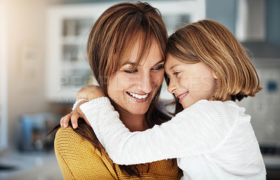 Buy stock photo Shot of a woman spending quality time at home with her little girl