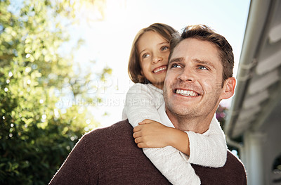 Buy stock photo Shot of a man spending quality time with his daughter in their backyard