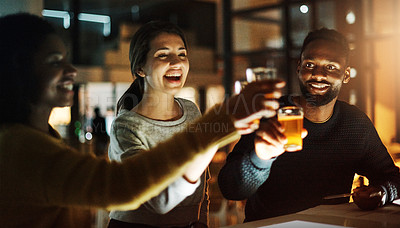 Buy stock photo Shot of a team of young businesspeople toasting with beers during a late night at work in a modern office