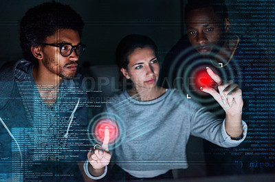 Buy stock photo Shot of a group of programmers working on  computer code at night