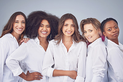 Buy stock photo Studio shot of a group of attractive young women posing together against a gray background