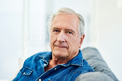 Buy stock photo Portrait of a senior man relaxing on the sofa at home