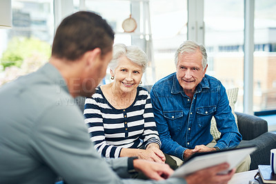 Buy stock photo Shot of senior couple having a consultation with a financial advisor at home